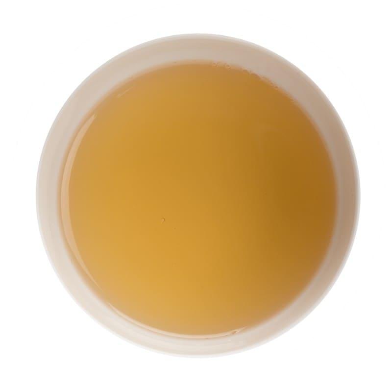 Robe du thé vert Yunnan en tasse